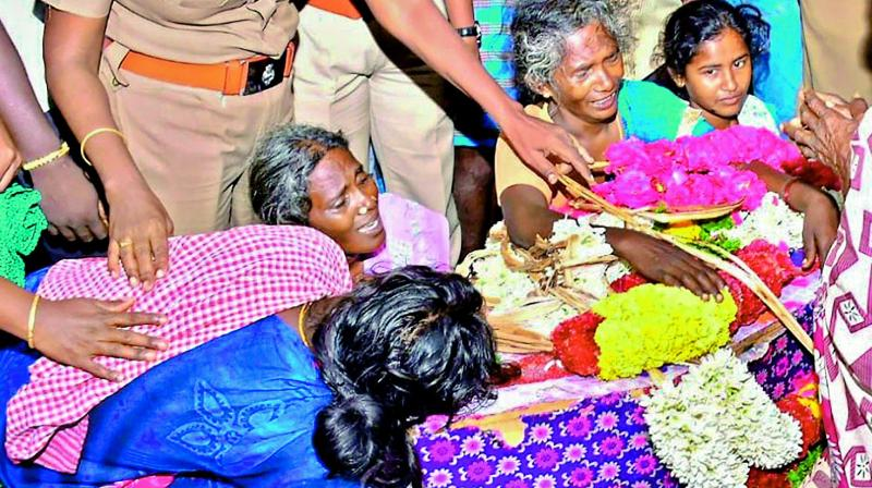 Family members and relatives mourn near the mortal remains of 2-year-old Sujith Wilson, who lost his life after he fell into a borewell, before his funeral in Tiruchirappalli on Tuesday. (Photo: PTI)