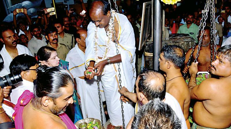 Chief Minister H.D. Kumaraswamy offers tulabhara at Kukke Subramanya temple on Tuesday  (Photo: KPN)