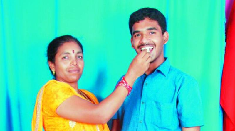 "All India second ranker K.V.R. Hemant Kumar's mother congragulating her son on his success. She said, ""My son aims to be a successful computer engineer and he also wants to do research in computer engineering. He used to study 12 to 15 hours a day."""