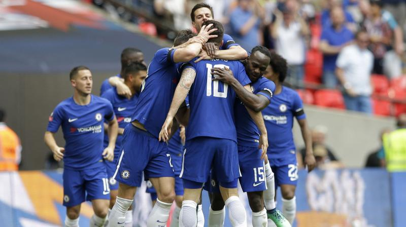 Chelsea  travel to the Liberty Stadium boosted by clinching a place in the FA Cup final against Manchester United after beating Southampton last weekend. (Photo: AP)