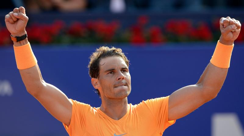 The 17-time Grand Slam champion, currently sidelined through injury, has also offered to open up his sports centre and tennis academy to people made homeless by the floods. (Photo: AFP)