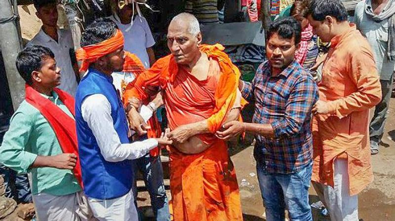 Supporters of Swami Agnivesh said he was dragged on the road, slapped and kicked by BJP workers who had assembled outside his hotel on Tuesday to oppose his presence in the district.  (Photo: PTI)