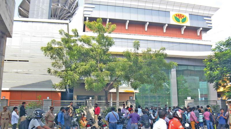 Media personnel stand guard in front of the Jaya TV where I-T officials conducted a raid, in Chennai on Thursday. (Photo: DC)