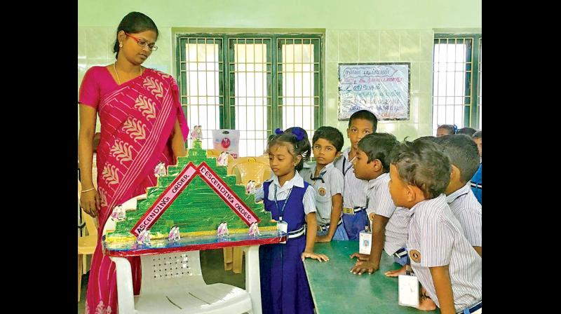 Kids from Sri Khongurunathar Vidyalaya in Tiruvallur learn ascending and descending order with the help of a model. (Photo: DC)