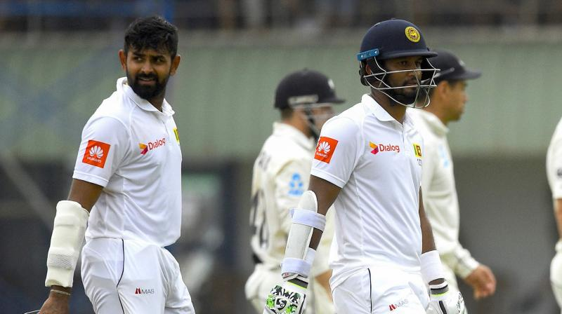 Karunaratne was unbeaten on 71 off 168 balls with two boundaries while Thirimanne was on 57 having faced 132 deliveries and hit four fours. (Photo: AFP)