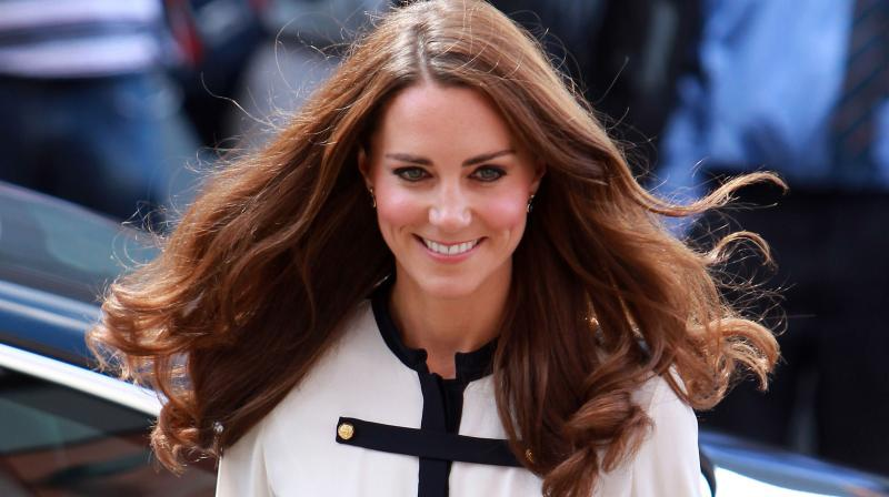 Britain's Catherine, the Duchess of Cambridge, arrives at the Machan Express Coffee bar in the centre of Birmingham on August 19, 2011, which was ransacked during the recent riots in the area. (Photo: AFP)