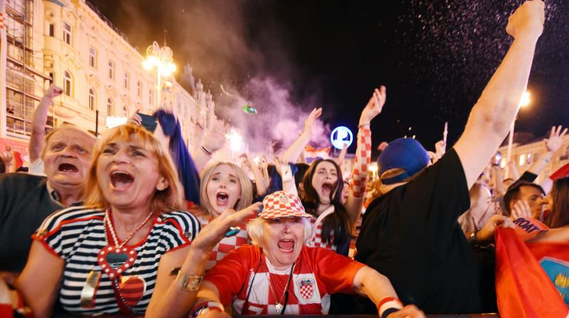 There were shouts of joy, hundreds of flares were lit and Croatian flags were waved as an estimated 15,000 fans celebrated the win for captain Luka Modric's side win in Zagreb's main square, where they had watched the match on a giant screen. (Photo: AFP)