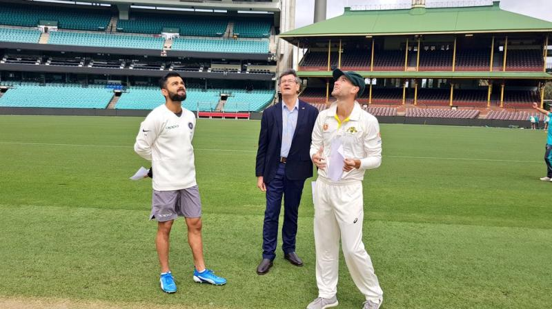 What took Twitterati by surprise was when Virat Kohli walked for the toss wearing shorts, whereas his rival captain Sam Whiteman was seen in the team's official kit. (Photo: Twitter / BCCI)