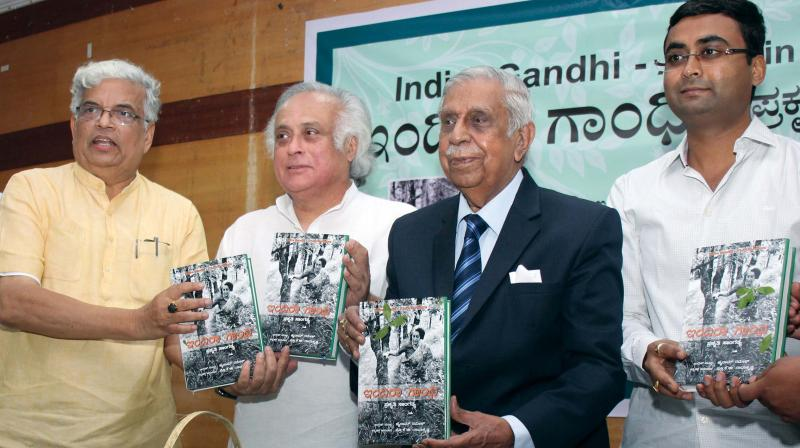 Rajya Sabha member Jairam Ramesh with former Supreme Court Chief Justice  M.N. Venkatachalaiah, Prof Radhakrishna and Dr Manu Chakarvarti releasing the Kannada version of Jairam Ramesh's book on Indira Gandhi in Bengaluru on Friday: DC