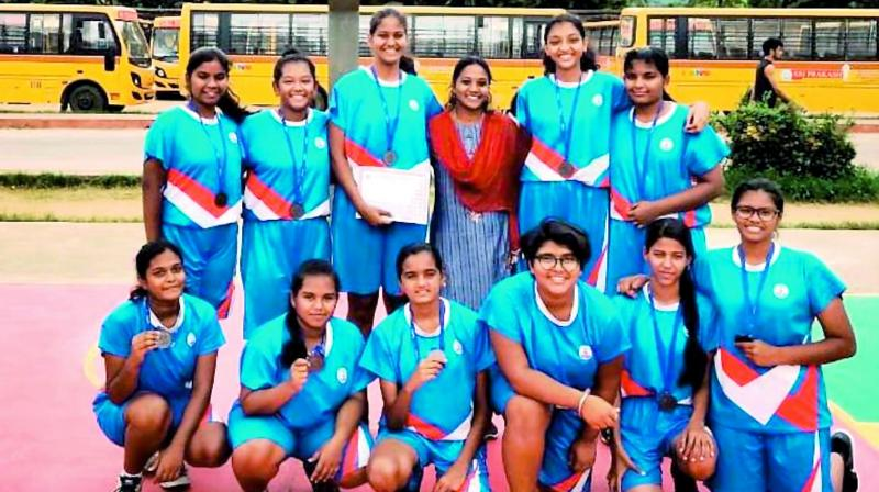 Members of the St Andrews girls team pose after securing a bronze medal in the CBSE Cluster VII basketball tournament held in Tuni, Visakhapatnam.