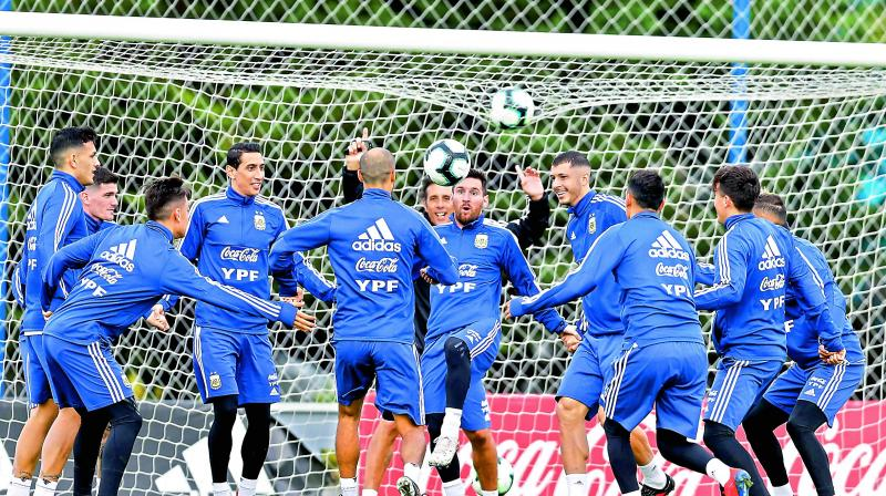 Lionel Messi (centre) practices with his Argentinian teammates in this file photo.