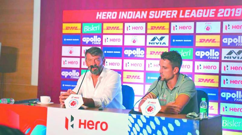Hyderabad Football Club manager Phil Brown (left) and striker Marcelo speak to reporters on Friday.