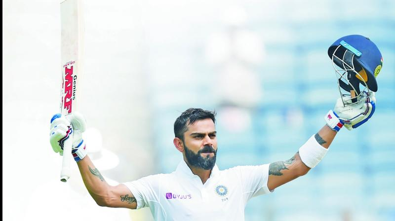 Virat Kohli  celebrates after  completing his double hundred during the second day of the  second Test match against SA in Pune. (Photo: AFP)