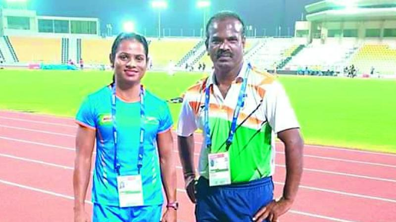 Sprinter Dutee Chand (left) poses with coach N. Ramesh after winning the 100m gold at the National Open Athletics Championships in Ranchi on Friday.