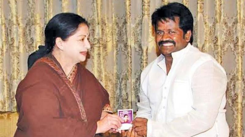 J. K. Ritheesh being admitted into AIADMK by  J. Jayalalithaa. (File photo)