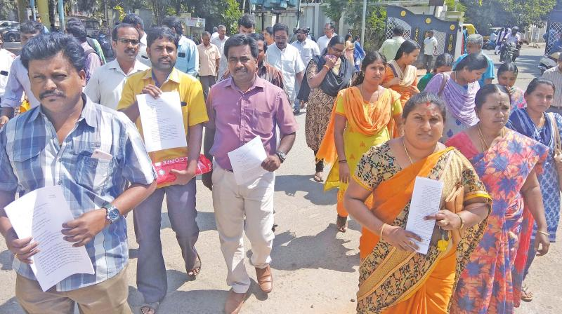 Parents of students studying in Amrita Vidyalayam  petition district collector urging him to ensure that they are not forced to purchase accessories by the school.(DC)
