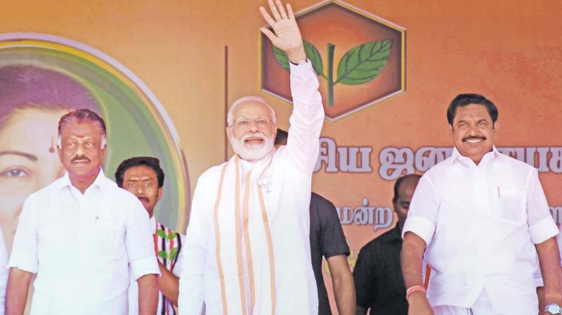 Prime Minister Narendra Modi with Chief Minister Edappadi K Palaniswami, Deputy CM O. Panneerselvam and other leaders at an election campaign rally for the Lok Sabha elections, in Andipatti, on Saturday. (PTI)