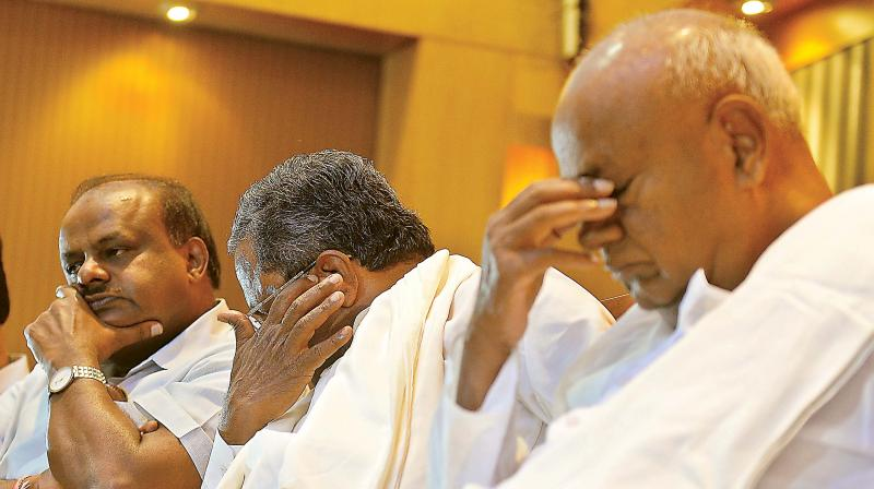 (From L) Chief Minister H.D. Kumaraswamy, former chief minister Siddaramaiah and JD(S) supremo H.D. Deve Gowda at a joint press conference in Bengaluru on Saturday.  (DC)