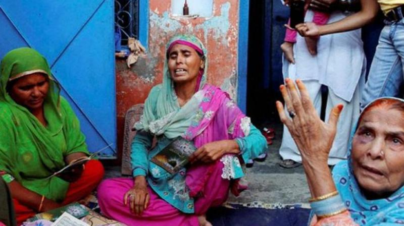The family of Ikhlaq, who was beaten to death by a mob, at Bishada in Dadri. (Photo: PTI | File)