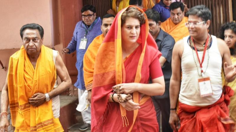 Wearing a red coloured saree, Priyanka performed a pooja at the temple along with Kamal Nath. (Photo: Twitter | @OfficeOfKNath)