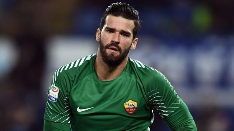 Liverpool signed Brazil international Alisson from AS Roma on Thursday, smashing the world record for a goalkeeper in a deal worth up to 72.5 million euros ($84 million). (Photo: AFP)