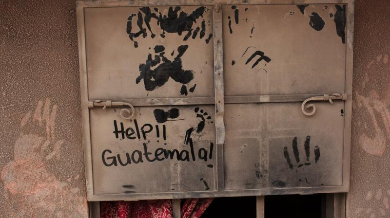 The fiery volcanic eruption in south-central Guatemala killed scores as rescuers struggled to reach people where homes and roads were charred and blanketed with ash.