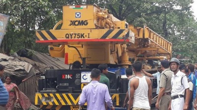 The driver absconded from the scene almost immediately, and soon, an angry mob started vandalising the crane. (Photo: ANI)
