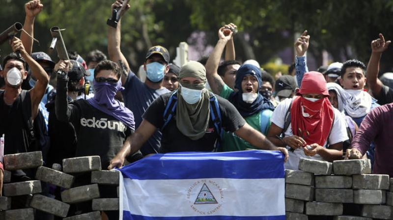 At least three dead, including police officer, in Nicaragua protests