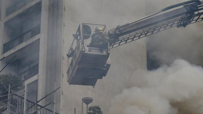 Seven firefighters were trapped by large fallen objects as they tried to search for people inside the factory. (Photo: AP | Representational)