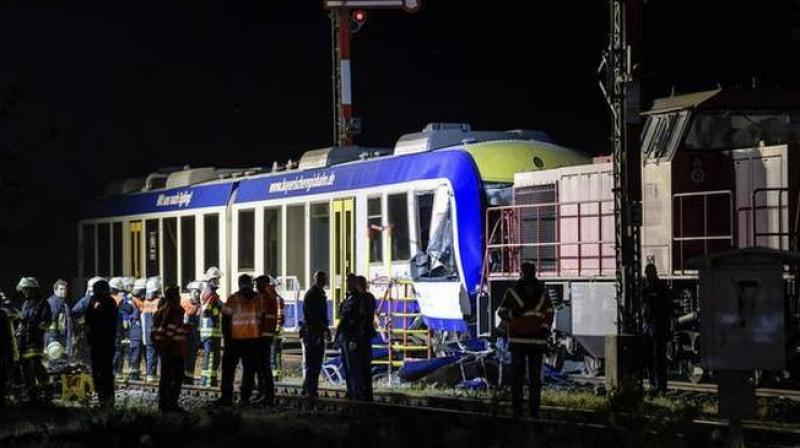 Emergency services attend the scene after a cargo train and a passenger train collided in Aichach, 50km west of Munich, southern Germany, Monday, May 7, 2018. (Photo:AP)