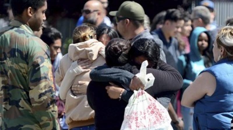 Students are reunited with family members outside Highland High School in Palmdale, California. (Photo: AP)