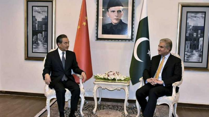 In this picture released by Press Information Department, visiting Chinese foreign minister Wang Yi, left, meets with his Pakistani counterpart Shah Mahmood Qureshi, in Islamabad.  (Photo: AP)
