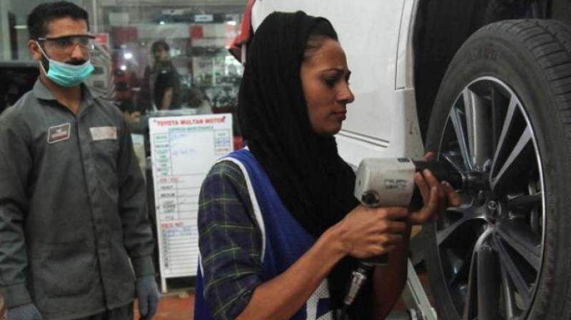 The 24-year-old spent years overcoming entrenched gender stereotypes and financial hurdles en route to earning a mechanical engineering degree and netting a job with an auto repairs garage in the eastern city of Multan. (Photo: AFP)
