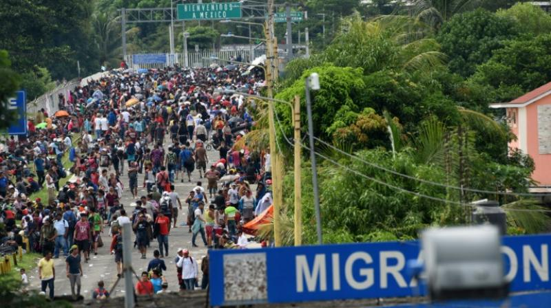 Honduran migrants taking part in a caravan heading to the US arrive at a border crossing point with Mexico in Ciudad Tecun Uman, Guatemala on October 19, 2018. (Photo: AFP)
