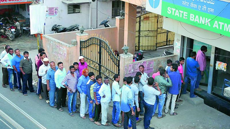 People line up at an State Bank of India ATM.