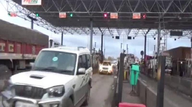 JD(U) MLA Ramchandra Prasad Singh along with his supporters crossed the toll bridge on National Highway in Rohtas without paying tax on Saturday. (Photo: ANI)