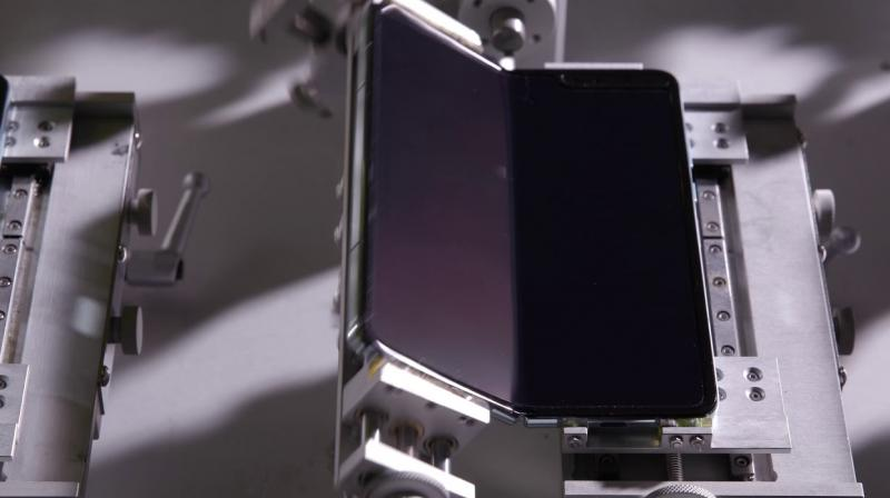 Samsung released a video showing robots folding Galaxy Fold handsets 200,000 times for its durability test.