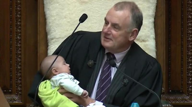 Trevor Mallard, the Speaker of New Zealand's parliament, cradled a lawmaker's baby while he presided over a debate in the House of Representatives. (Photo: Twitter/ Trevor Mallard)