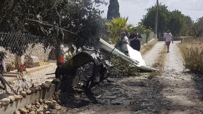 Seven people including two children were killed in a mid-air collision between a helicopter and a light aircraft over Spain's Mallorca island on Sunday, authorities said. (Photo: AP)