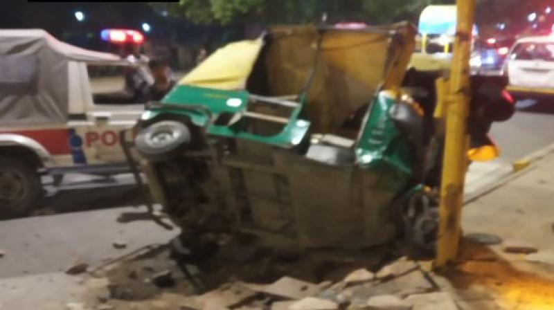 Two people lost their lives while two others were injured when the driver of a dumper truck lost control and ran over autos and pedestrians near India Gate on Man Singh Road in the wee hours of Tuesday. (Photo: Twitter/ ANI)