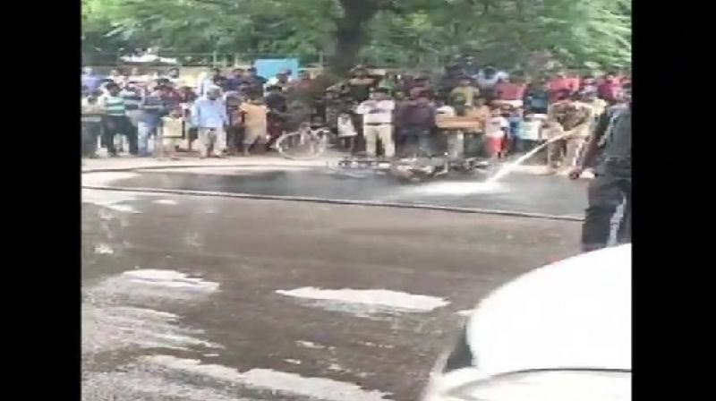 A man allegedly set his motorbike on fire after Delhi traffic police issued a challan to him for violating traffic rules in Sheikh Sarai area on Thursday. (Photo: ANI)