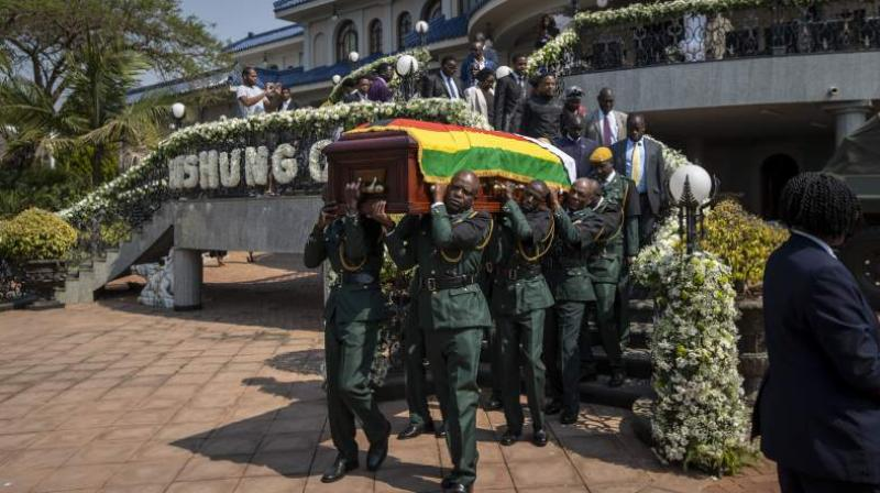 The burial of Zimbabwe's founding president, President Robert Mugabe , will be delayed for at least a month until a special mausoleum can be built at a prominent spot at the national Heroes' Acre monument, the latest turn in a dramatic tussle between his family and the country's current leader, a once-trusted deputy who helped oust Mugabe from power. (Photo: AP)