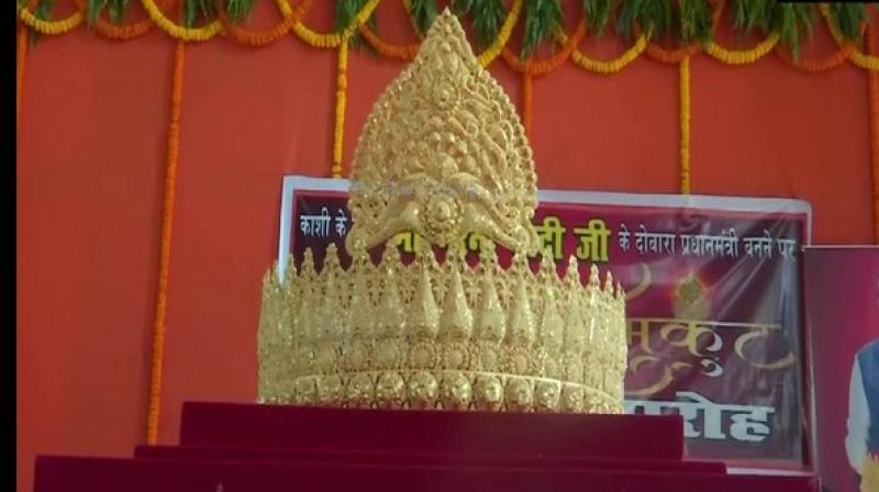 An ardent fan of Prime Minister Narendra Modi offered a gold crown weighing 1.25 kg to Lord Hanuman at Sankat Mochan Temple in Varanasi to mark Prime Minister Narender Modi's 69 th birthday. (Photo: ANI)