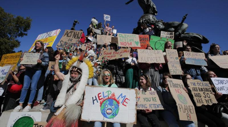 Young people afraid for their futures protested around the globe Friday to implore leaders to tackle climate change, turning out by the hundreds of thousands to insist that the warming world can't wait any longer. (Photo: AP)
