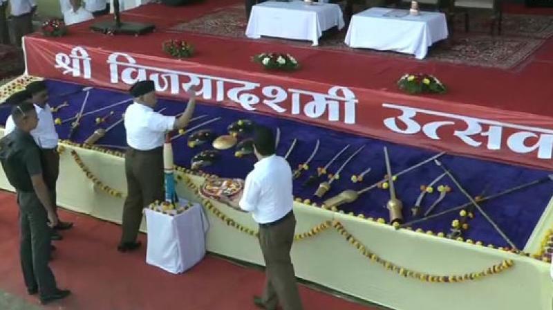 Rashtriya Swayamsevak Sangh or RSS chief Mohan Bhagwat on Tuesday performed 'shastra puja' (Ritual for weapons) at the annual Vijayadashmi festival in Maharashtra's Nagpur. (Photo: ANI)