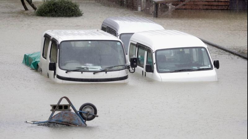 Japan's military scrambled Sunday to rescue people trapped by flooding in the aftermath of powerful Typhoon Hagibis, which killed at least eleven people, caused landslides and burst rivers. (Photo: AP)