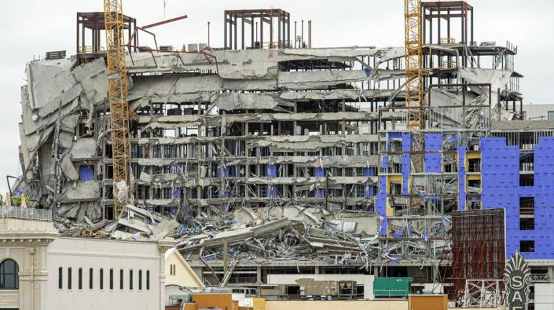 One person died and at least 18 others were injured Saturday when the top floors of a New Orleans hotel that was under construction collapsed, officials said. (Photo: AP)