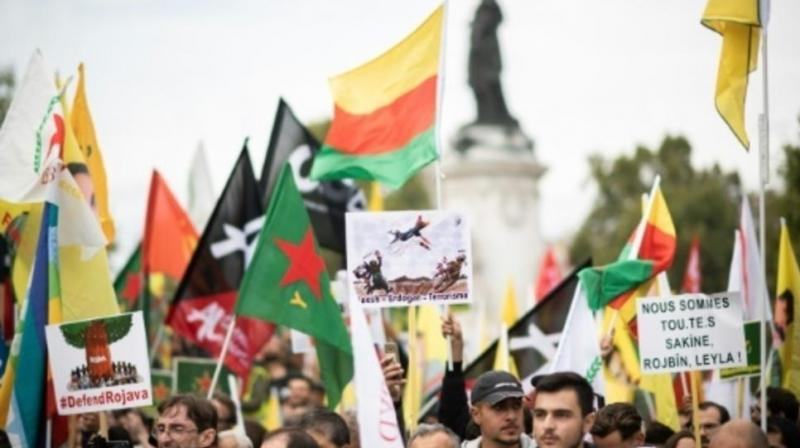 "Thousands of people, some shouting ""Erdogan terrorist"", took to the streets of Paris and other European cities on Saturday in protest at the Turkish assault on Kurds in Syria. (Photo: AFP)"