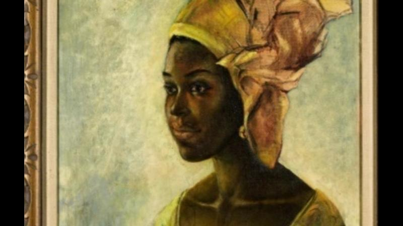 """A painting by the Nigerian artist responsible for the """"African Mona Lisa"""" sold at auction in London on Tuesday for £1.1 million after the family who owned it googled the signature and realised its importance. (Photo: AFP)"""