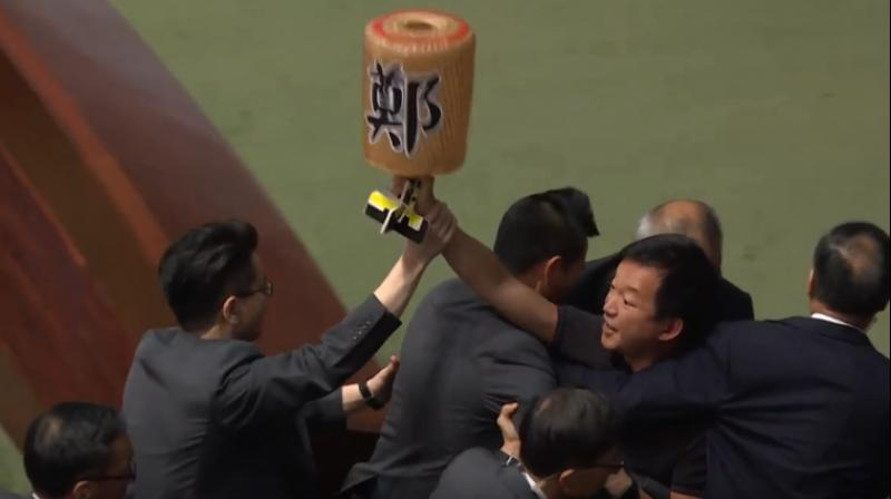 Pro-democracy lawmakers were dragged out of Hong Kong's legislature by security guards on Thursday after they heckled the city's pro-Beijing leader for a second day running, the latest outburst of political rancour in the strife-torn city. (Photo: screengrab/ AFP video)